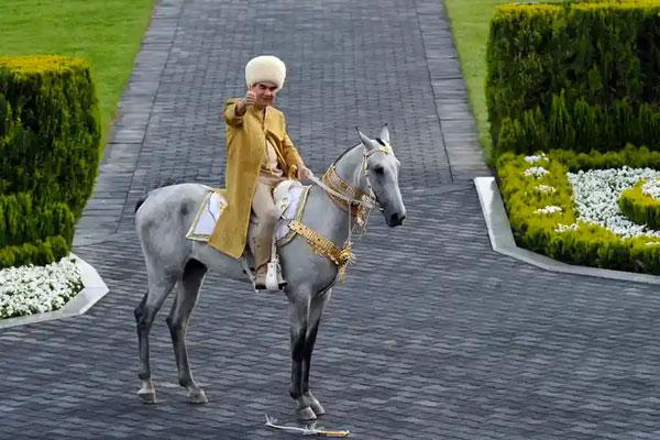 Turkmenistan's President Gurbanguly Berdymukhamedov rides an Akhal